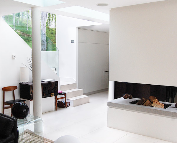 Mews development: open plan living illuminated by front glass extension, Primrose Hill, London
