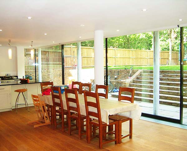 Glass wall brightens basement in house remodelling