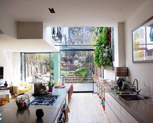 House development Highgate: view of excavated garden from rebuilt kitchen