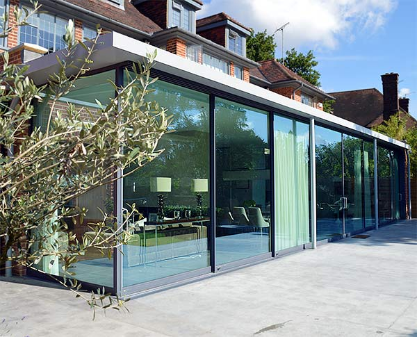 Full width glass house extension
